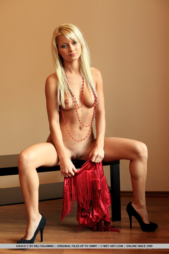 Naked blonde covering boobs and pussy