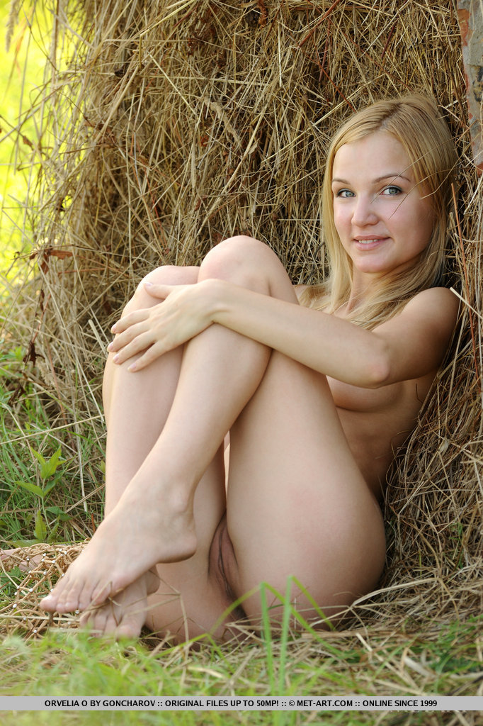 Naked blonde fucked in a field