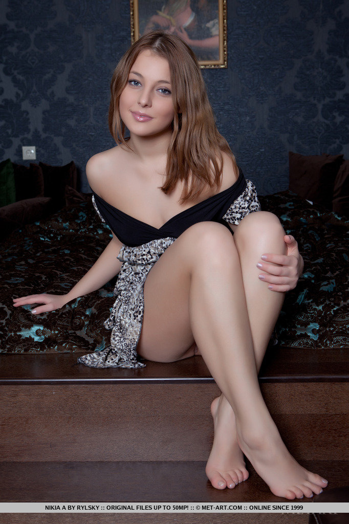 Foxy brunette model with blue eyes Nikia A strips out of her skirt