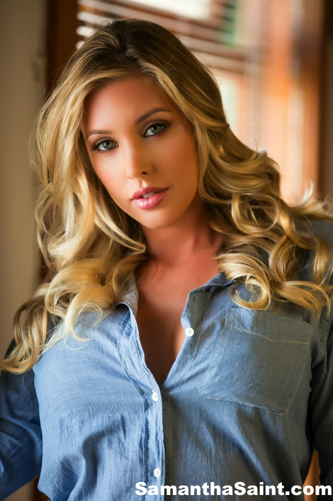Famous pornstar Samantha Saint shows off her pretty face while modeling solo