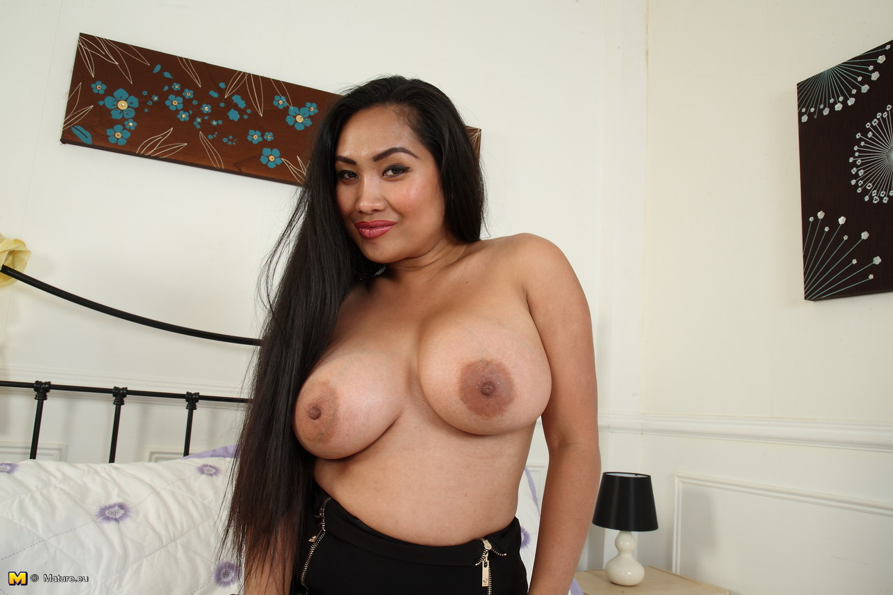 Asian housewife unzips her black skirt prior to exposing her hooters