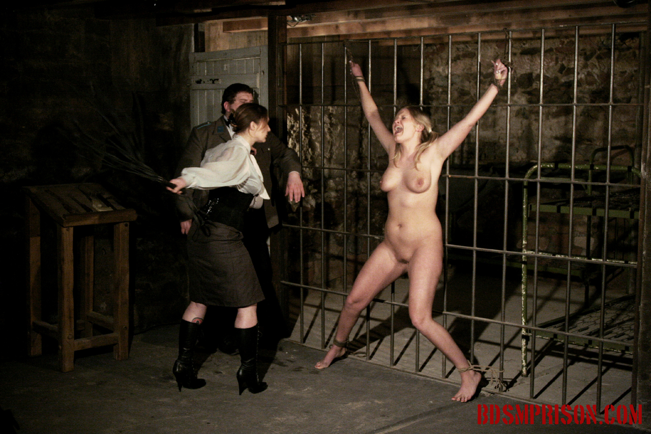 Sporty bdsm model alex zothberg in bondage and whipped nude by two masked men