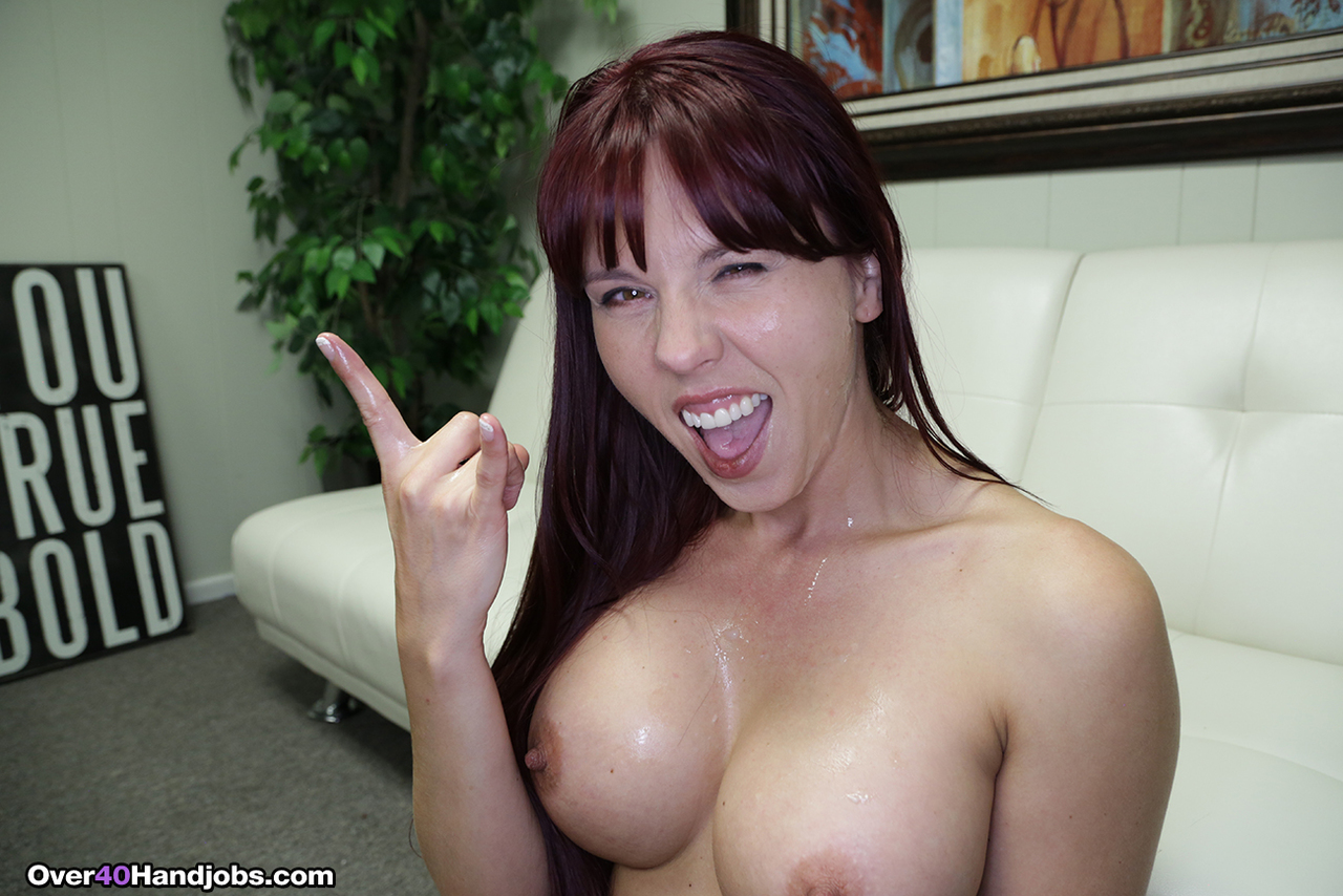 Busty over 40 woman Amber Chase pleasures a hard cock POV style