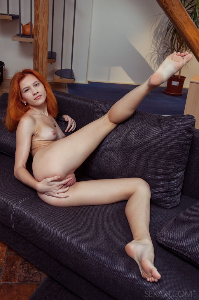 Thin redhead Ambre fondles her tiny tits before petting her creamy pussy