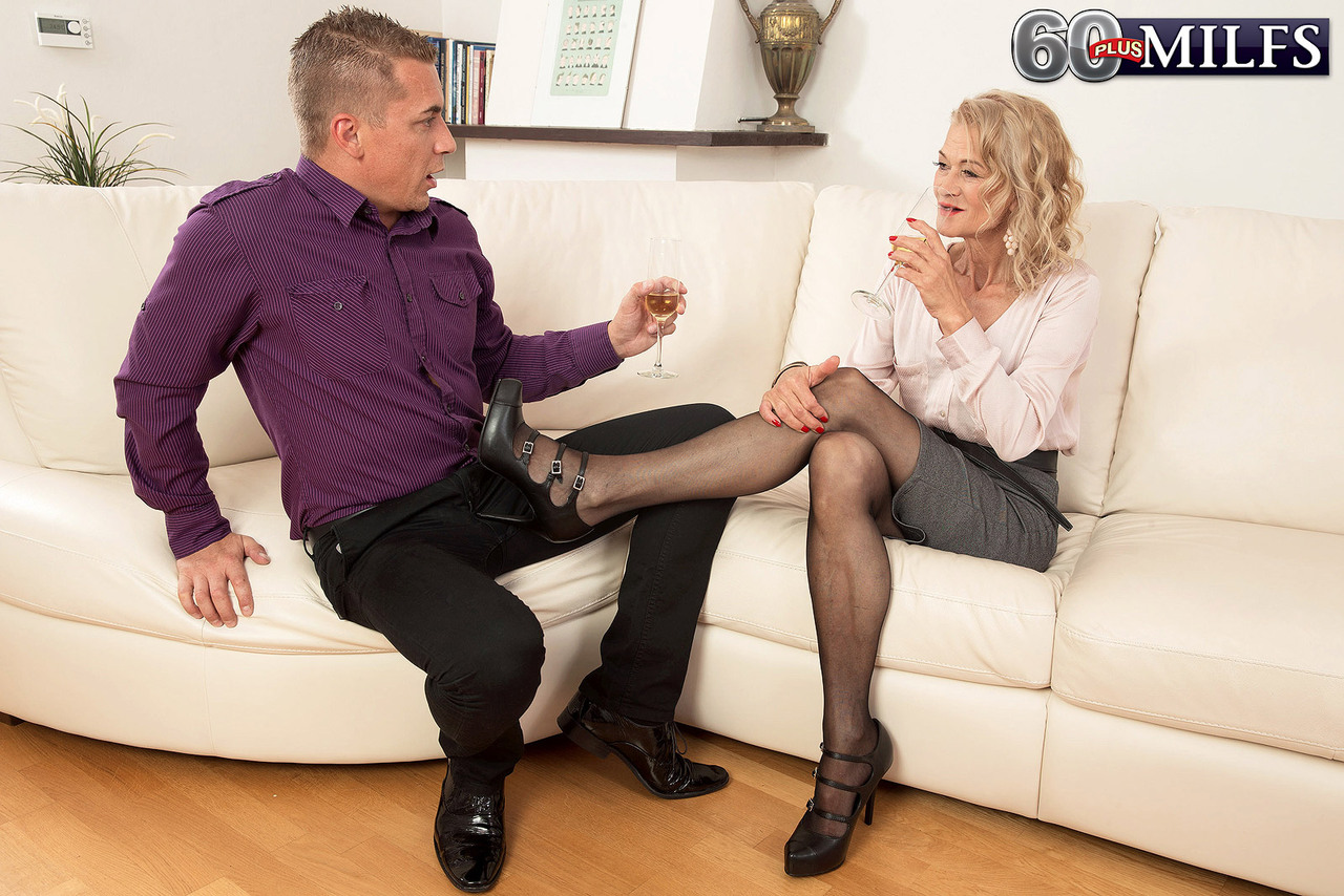 hot granny beata shows a younger guy a real good time in black