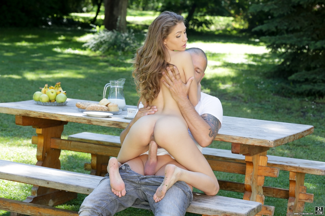 Sexy teen on a picnic table due time