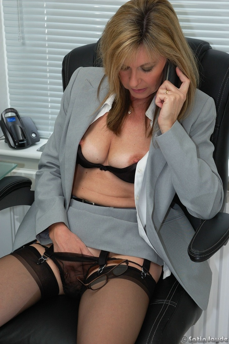 Mature woman masturbating while at work