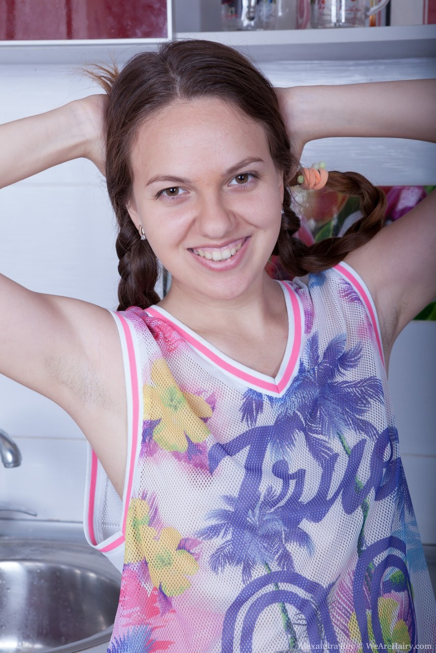 Teen amateur Alexandra Rey stretches out her beaver in braided pigtails
