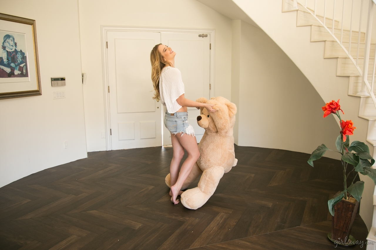 Clothed blonde teen takes her stuffed teddy bear with her wherever she goes