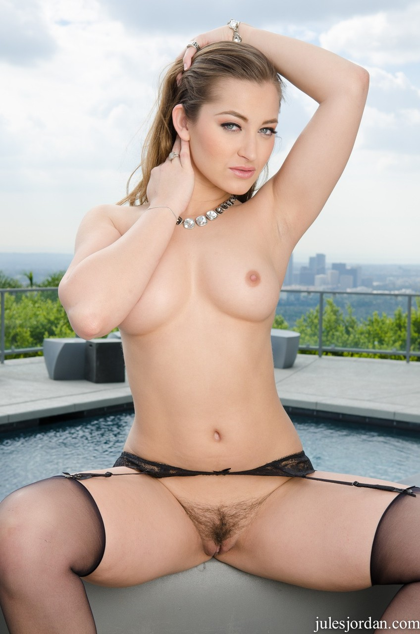 Solo model Dani Daniels strips down to garters and nylons on rooftop patio