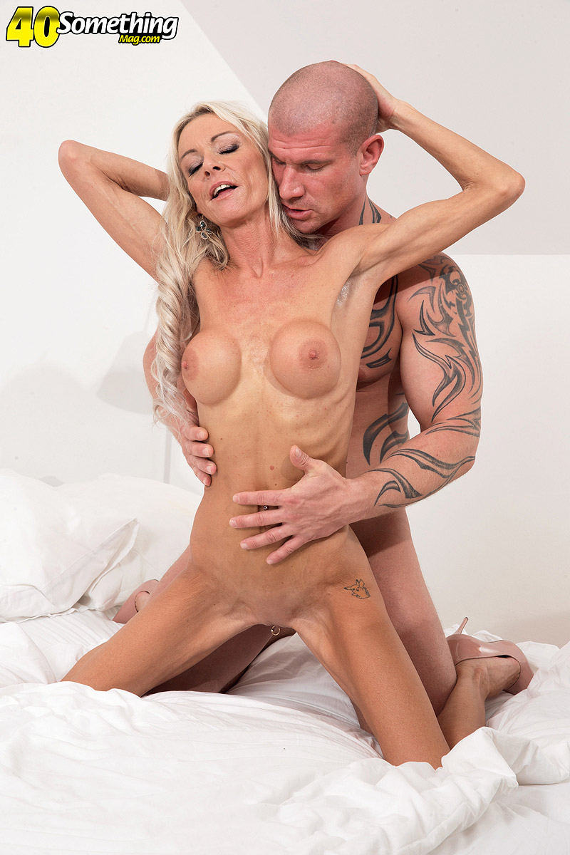 Older blonde woman Alex Starr lets a young man strip and fuck her