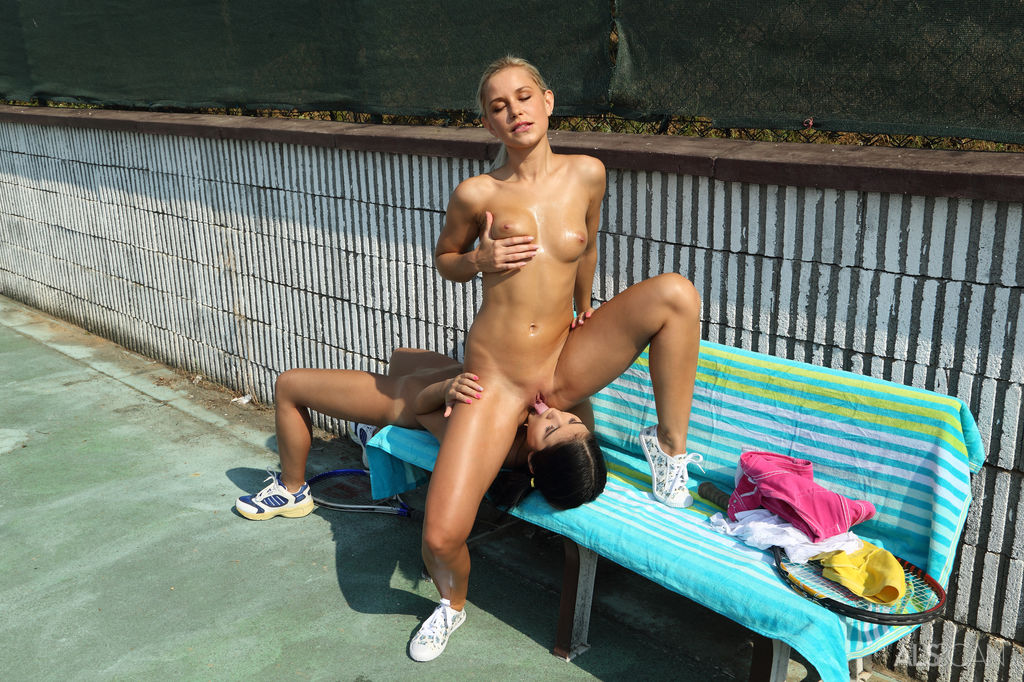 Young girls toy each others pussy on a bench after a tennis match