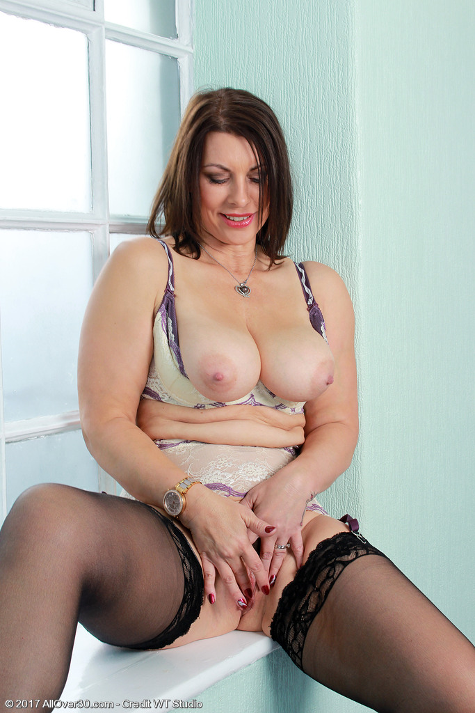 Sexy mature Raven frees her gorgeous big breasts to masturbate in hot lingerie
