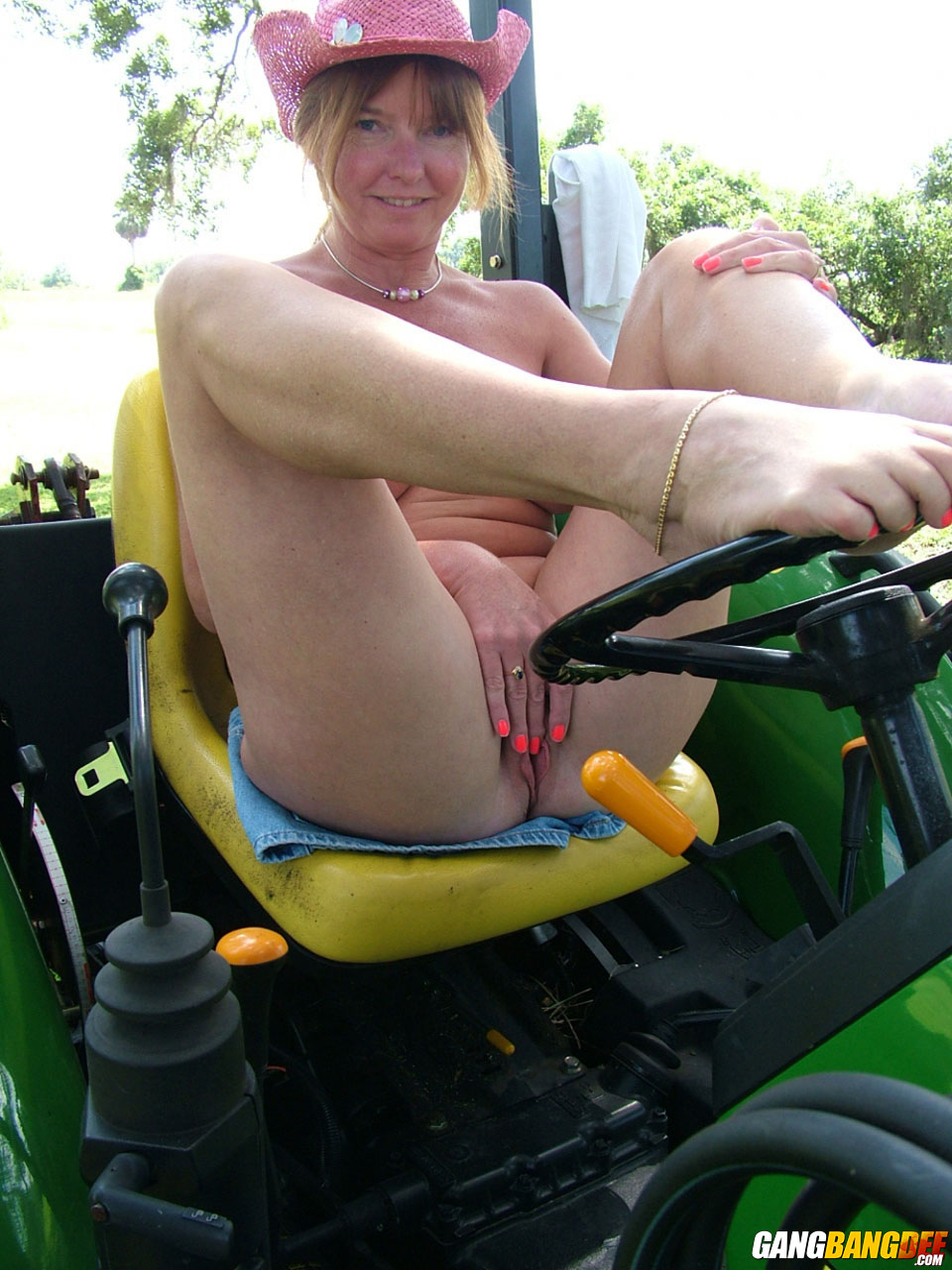 Toy tractor on hairy pussy