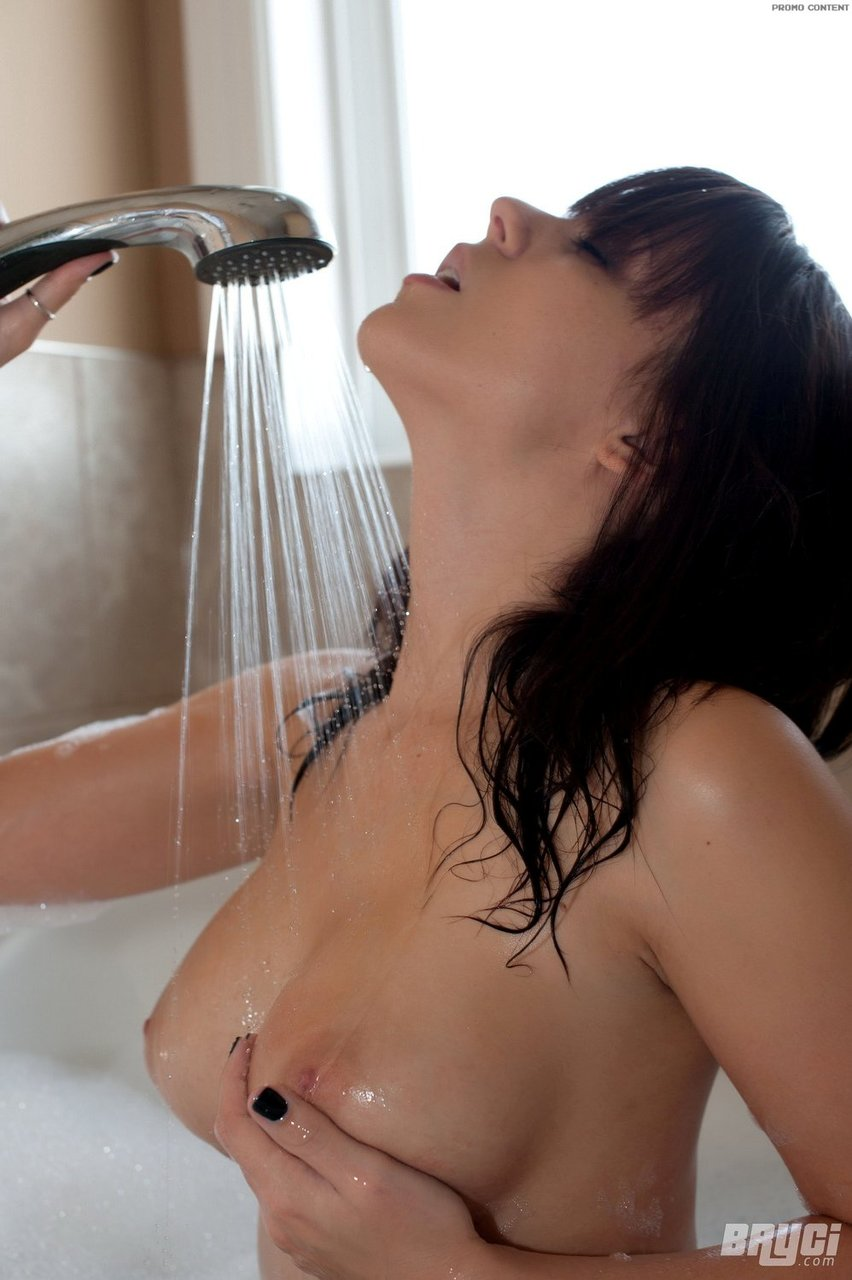 Hot brunette Bryci lets her big tits and perfect ass crest the surface in bath