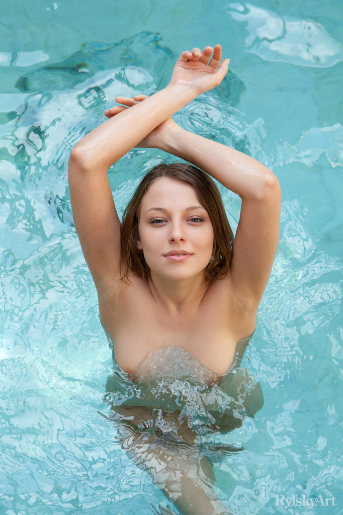 Cute slender Nikia naked in the pool showing wet small tits  shaved pussy
