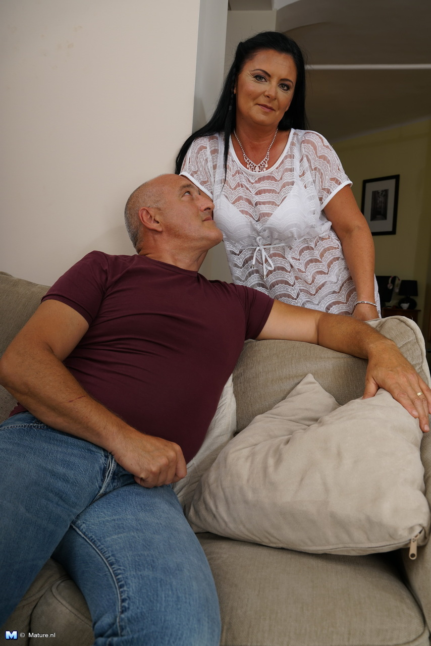 mature woman grits her teeth after getting naked for hard doggy