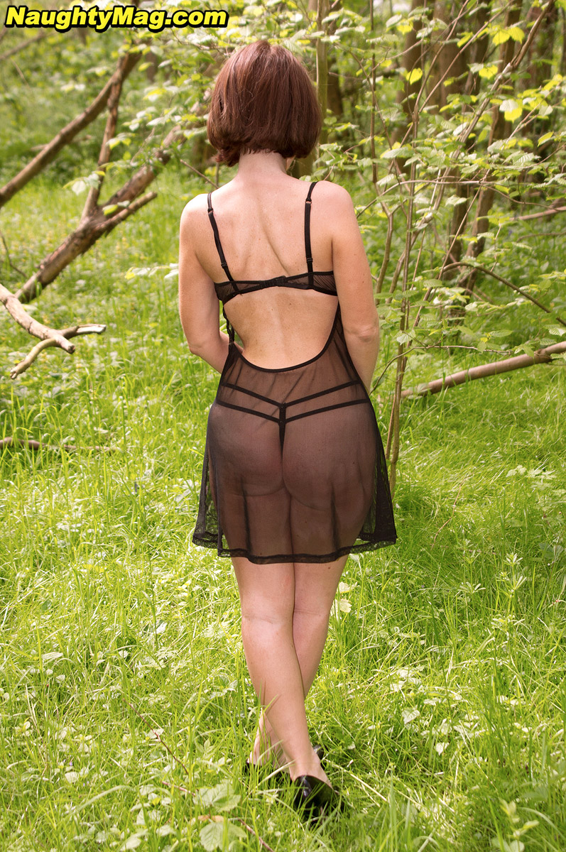 mature-backyard-pussy ... Mature lady in sheer black lingerie flashing her shaved pussy in  backyard ...