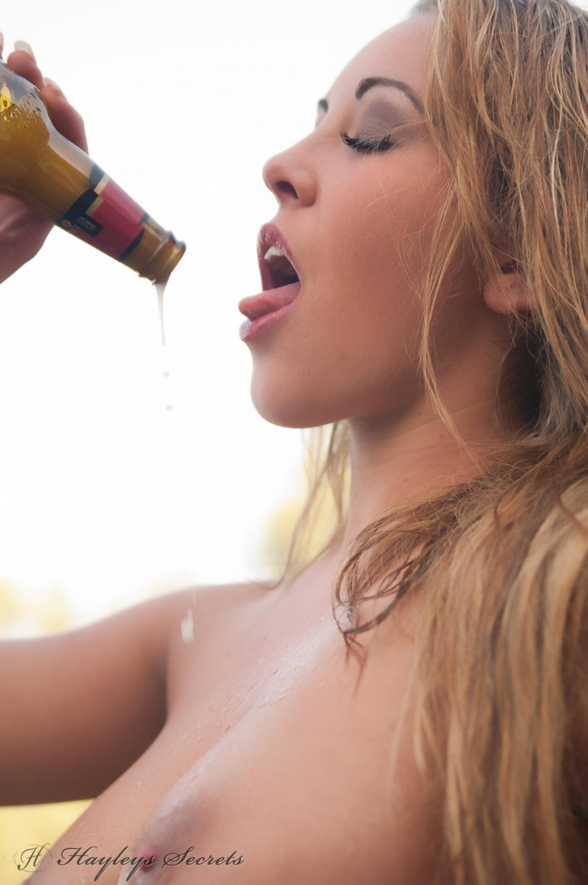 Beautiful female Ami Hannah cracks a cold beer while and pours it on her tits