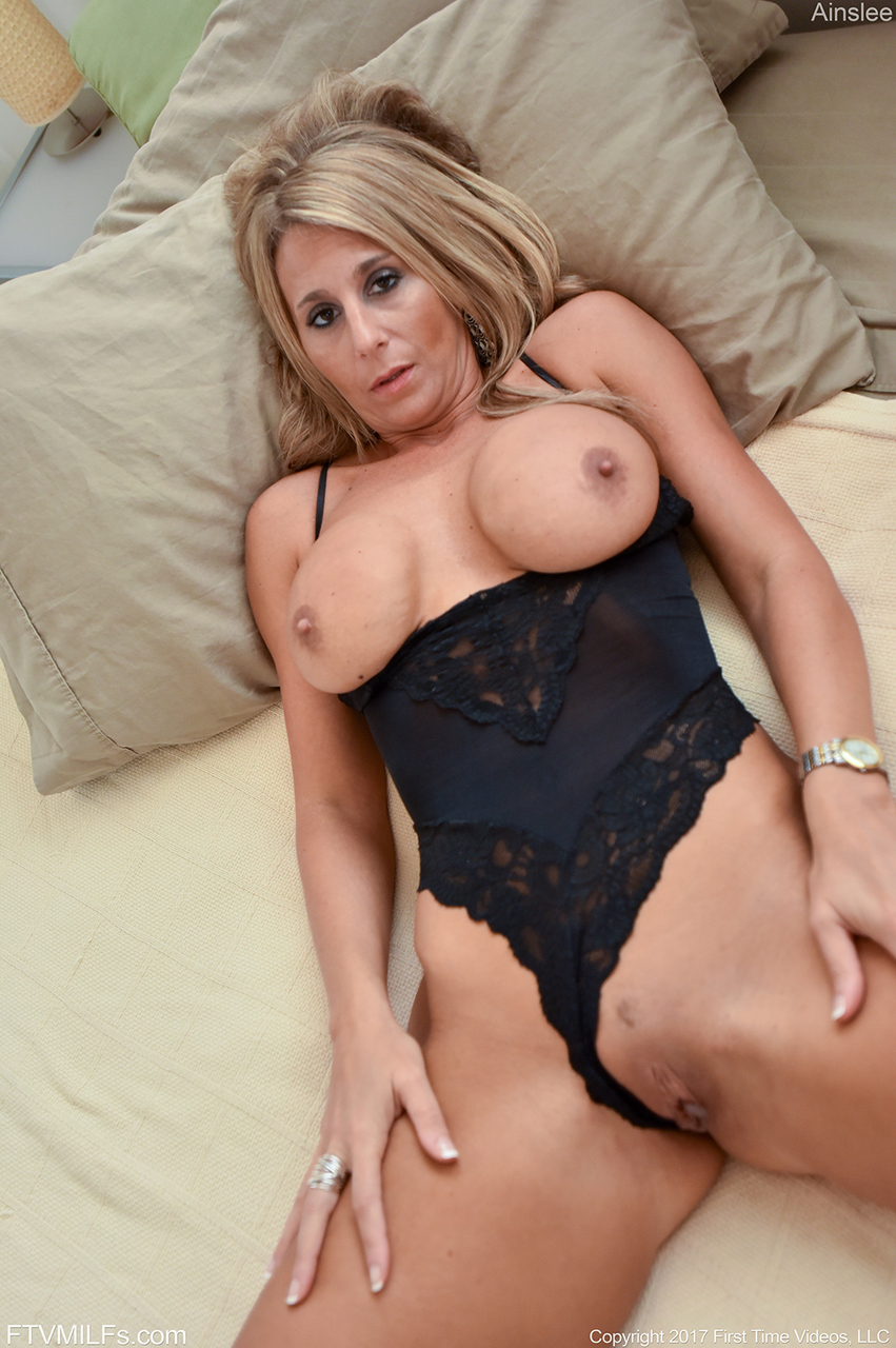 older blonde milf flashes her big natural tits indoors and outdoors