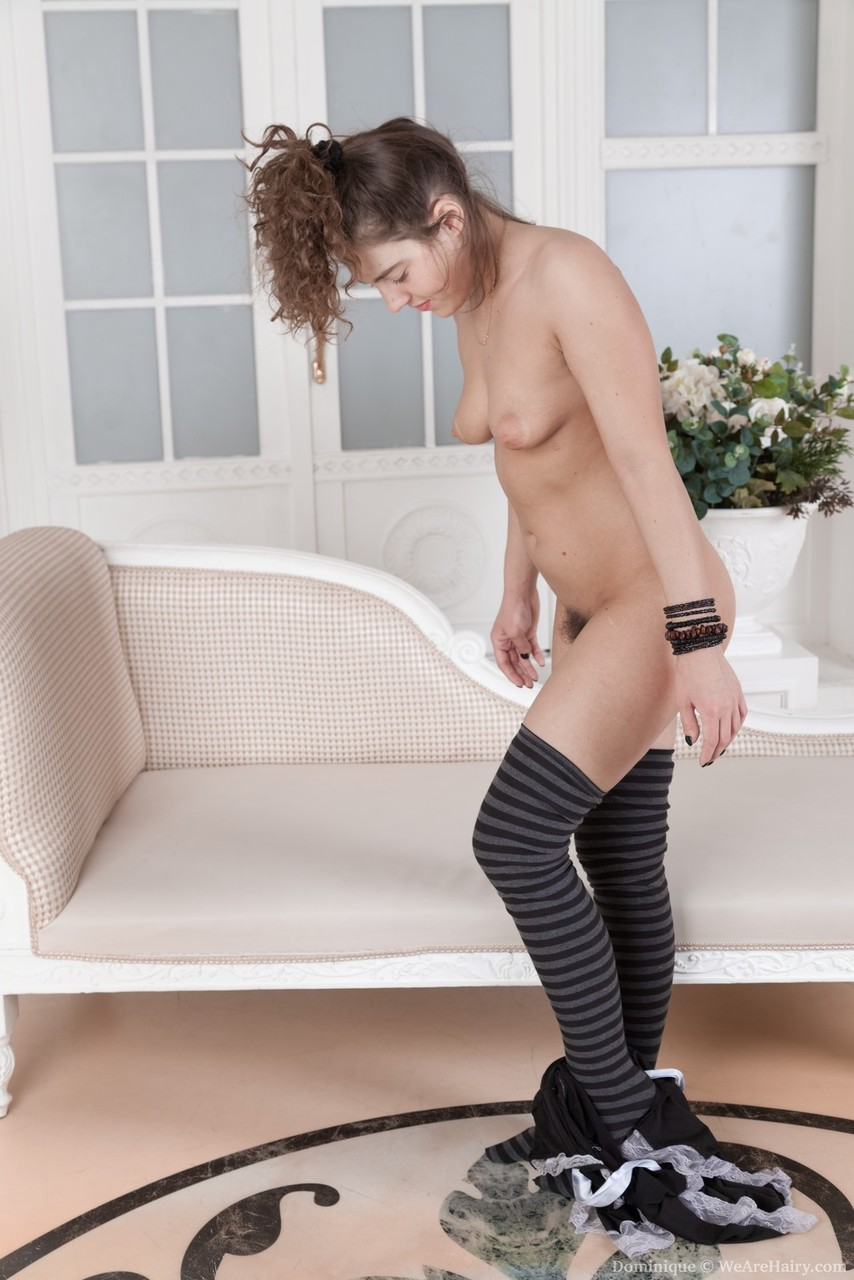 Sexy maid Dominique sheds her uniform to expose her hairy vagina in knee socks