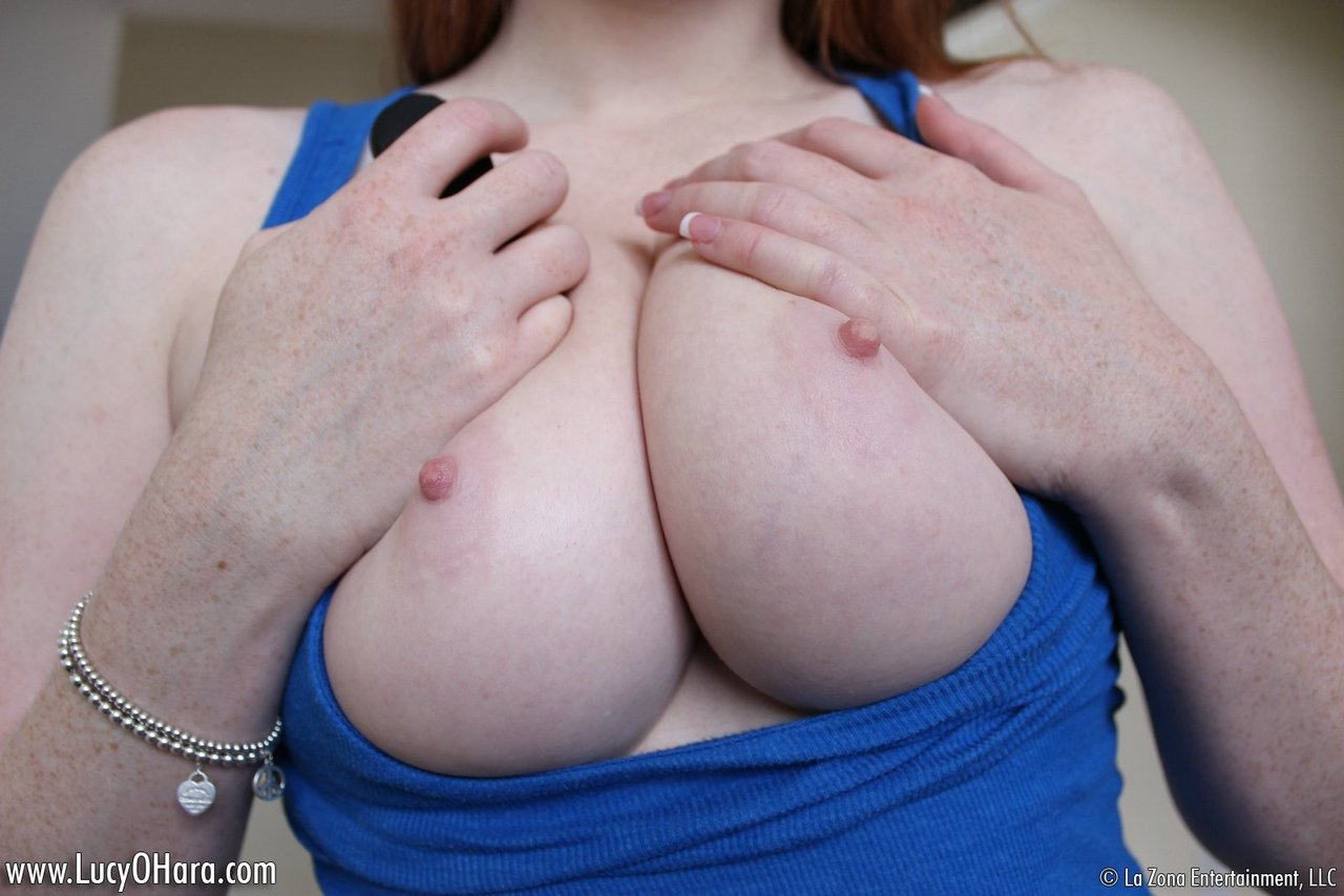 Pale redhead Lucy OHara has fun sucking and riding her sex toy
