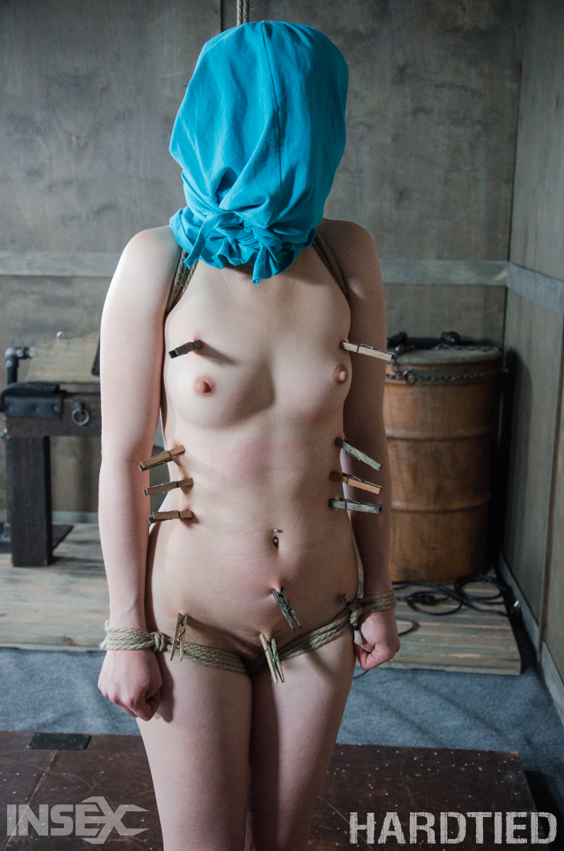 Short haired girl Bonnie Day is subjected to humiliating abuse in a dungeon