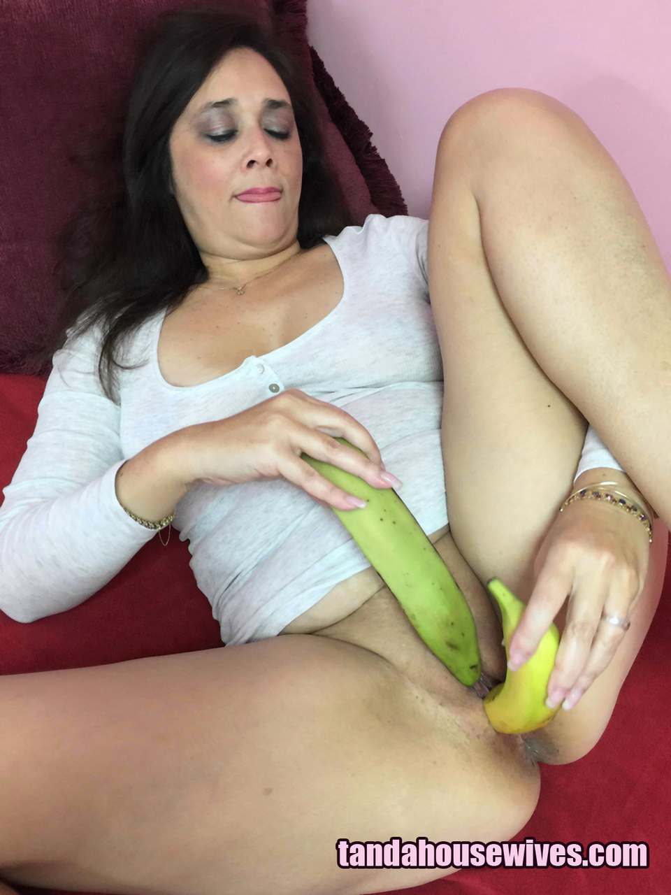 Young russian wife playing with banana