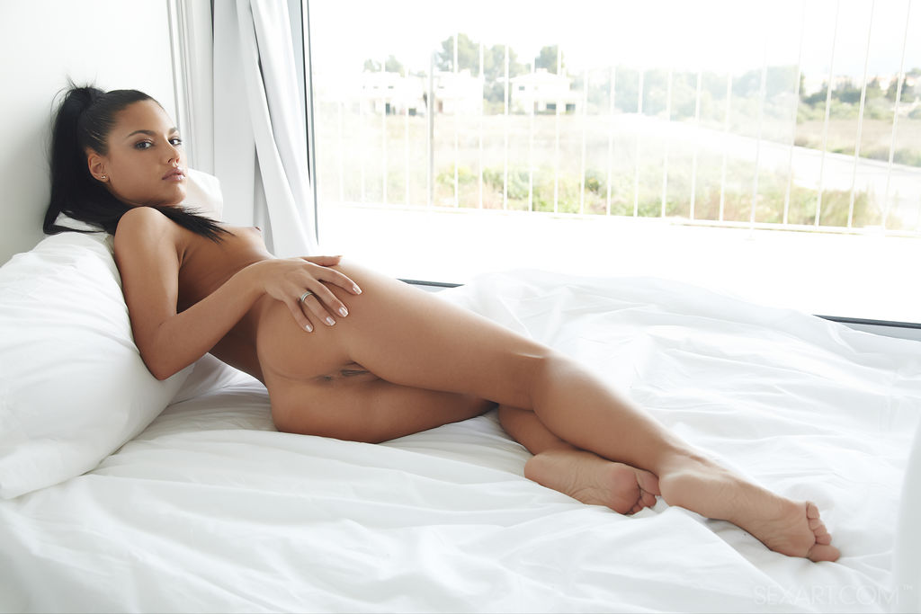 beautiful latina apolonia plays with her delectable pussy in the