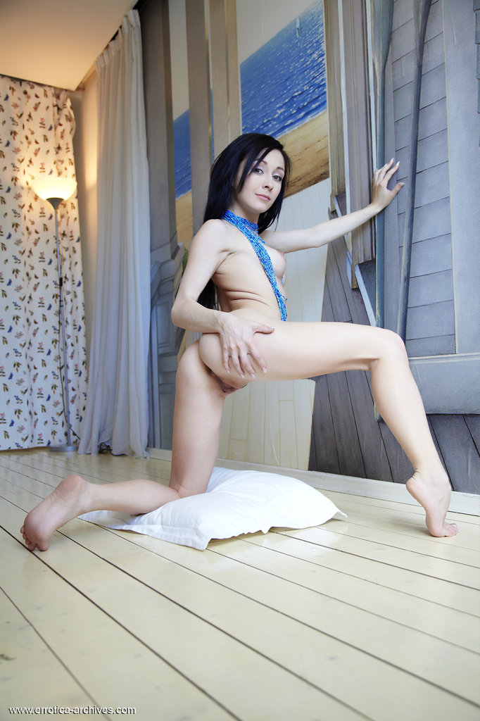 Brunette with perky tits shows off her snatch with legs spread open
