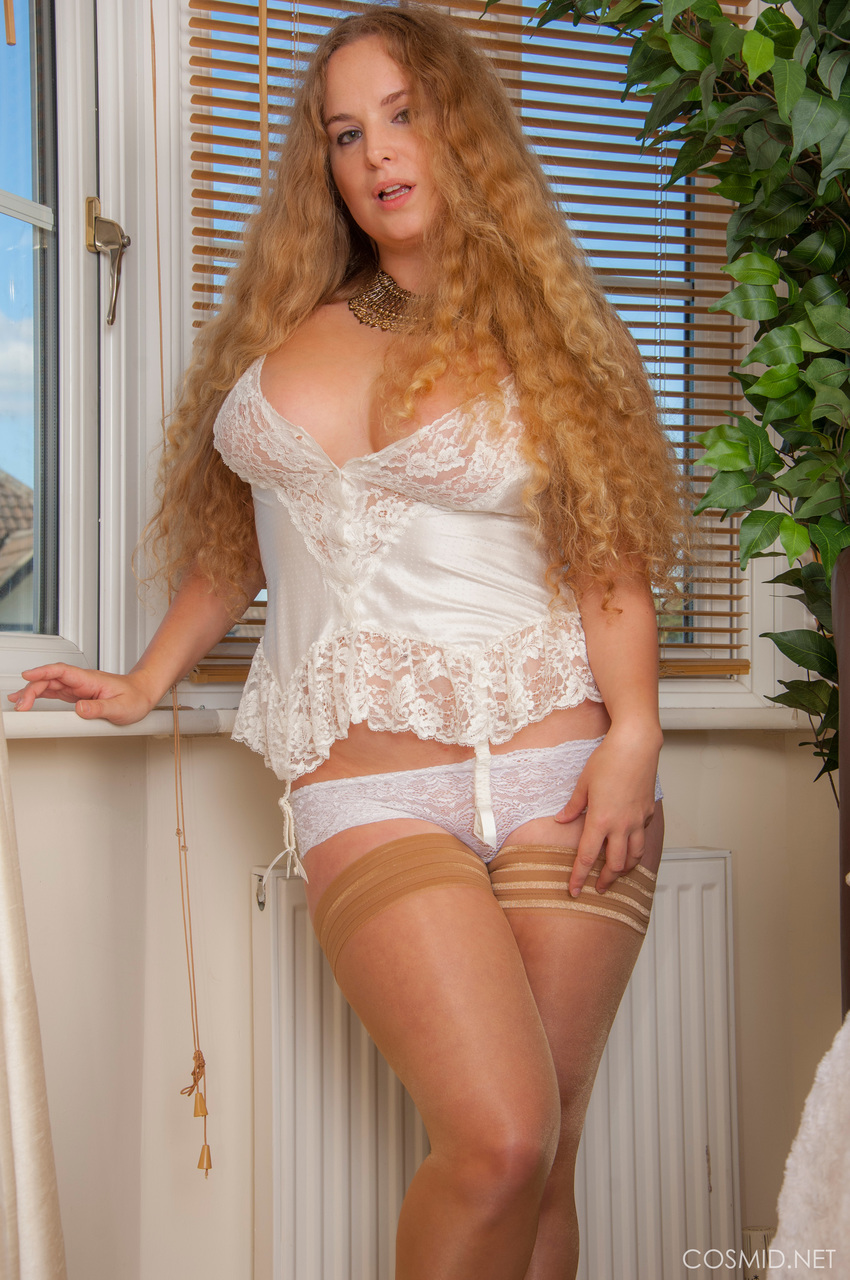 Solo girl with long curly hair Jezzabelle Banks bares her tits in lace panties