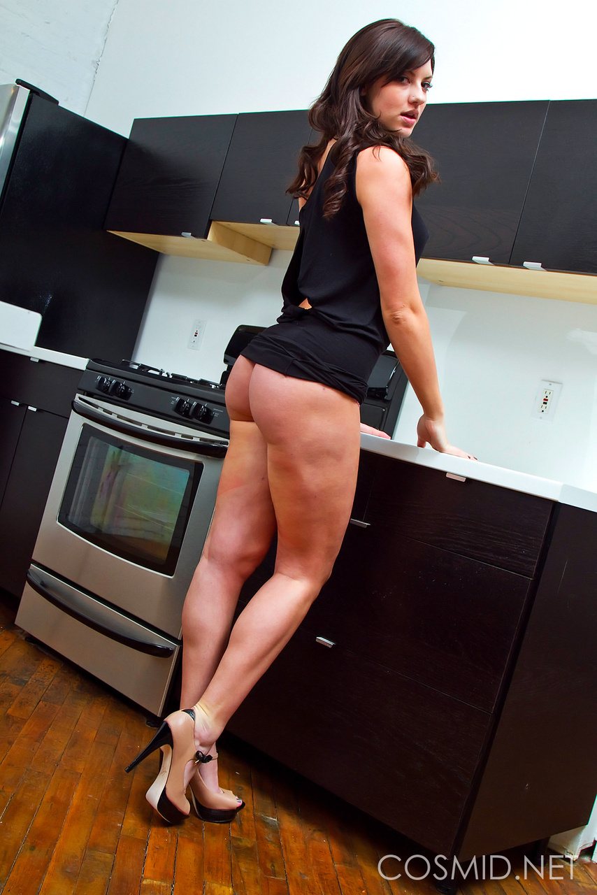 Amateur model Allie Furman removes her black dress to pose in a thong only