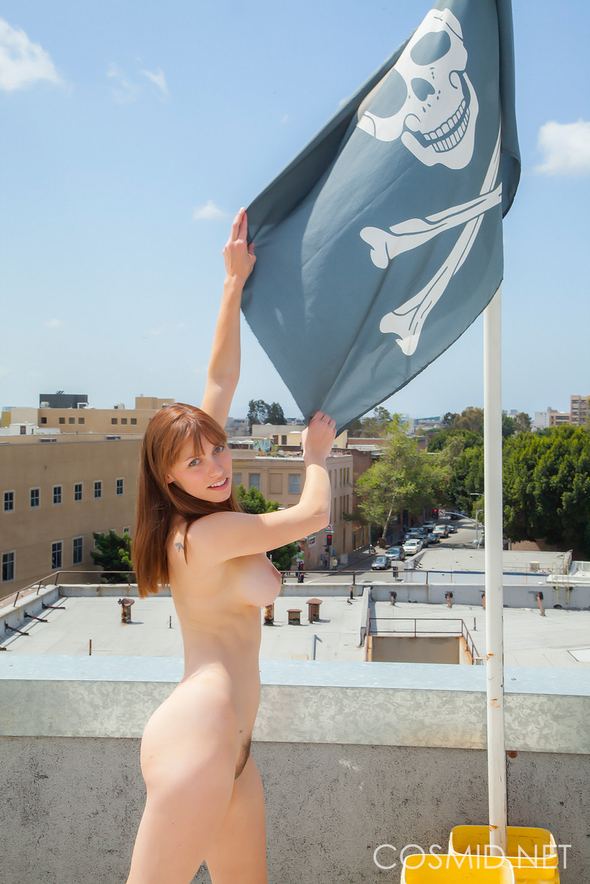 Attractive redhead essica Fisher undressing outside to pose nude in public