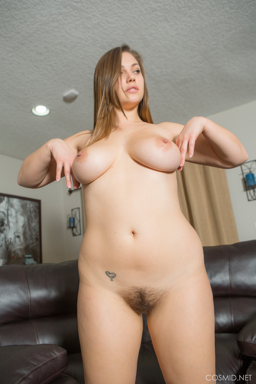 Big fat woman peeling her white bodysuit to display her hugs tits  ass