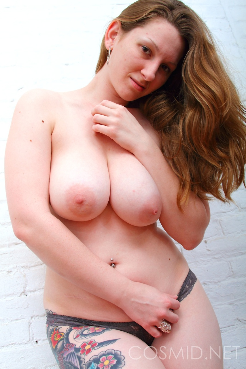 Natural redhead Amber takes off her gym pants to bare her fat ass