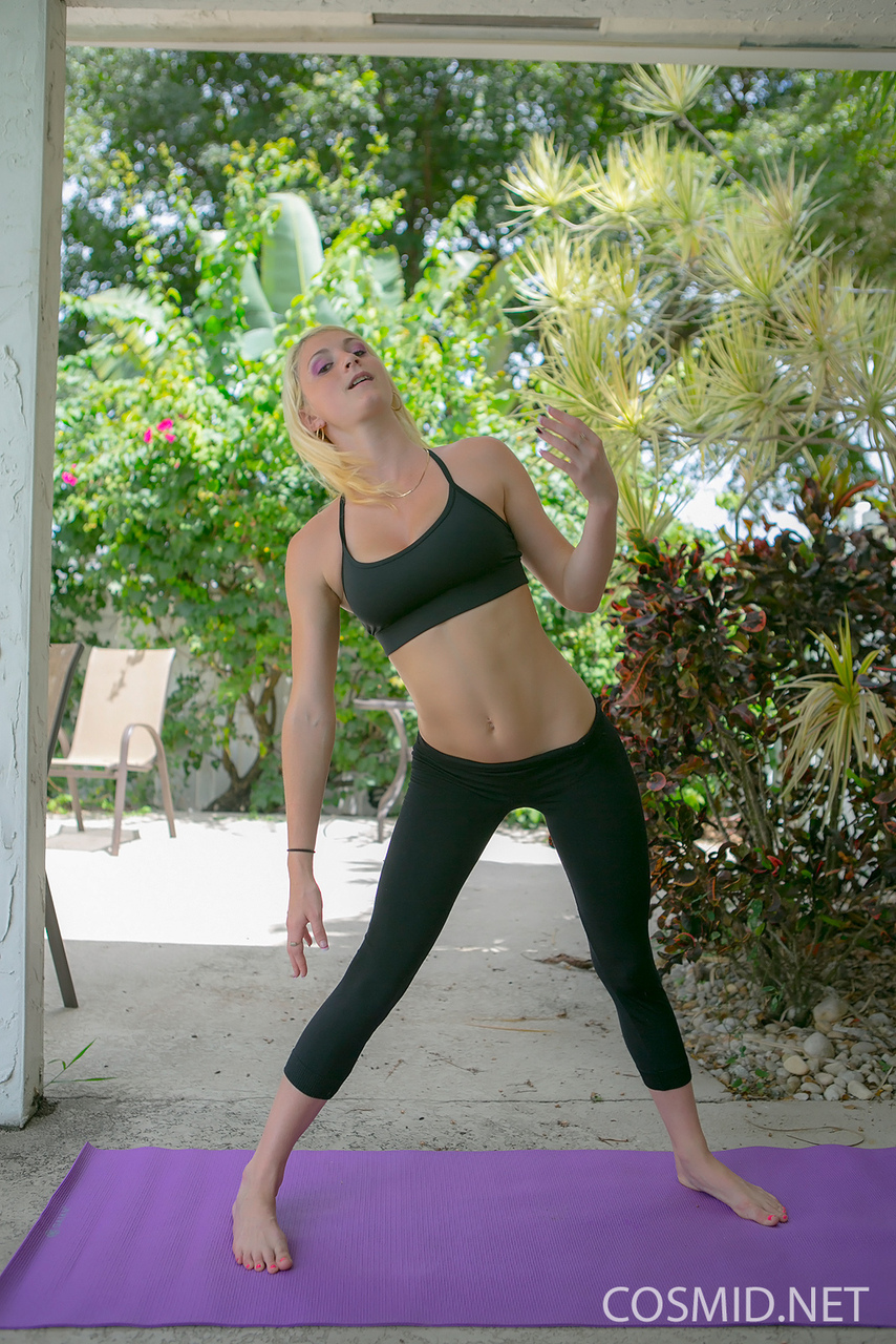 Exercising girl in yoga pants bending over to show hot ass outdoors