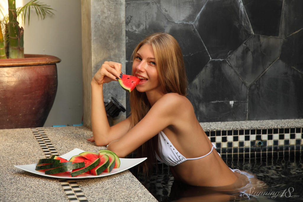 Leggy 18 year old Anjelica soaks her yummy pussy in watermelon juice outdoors