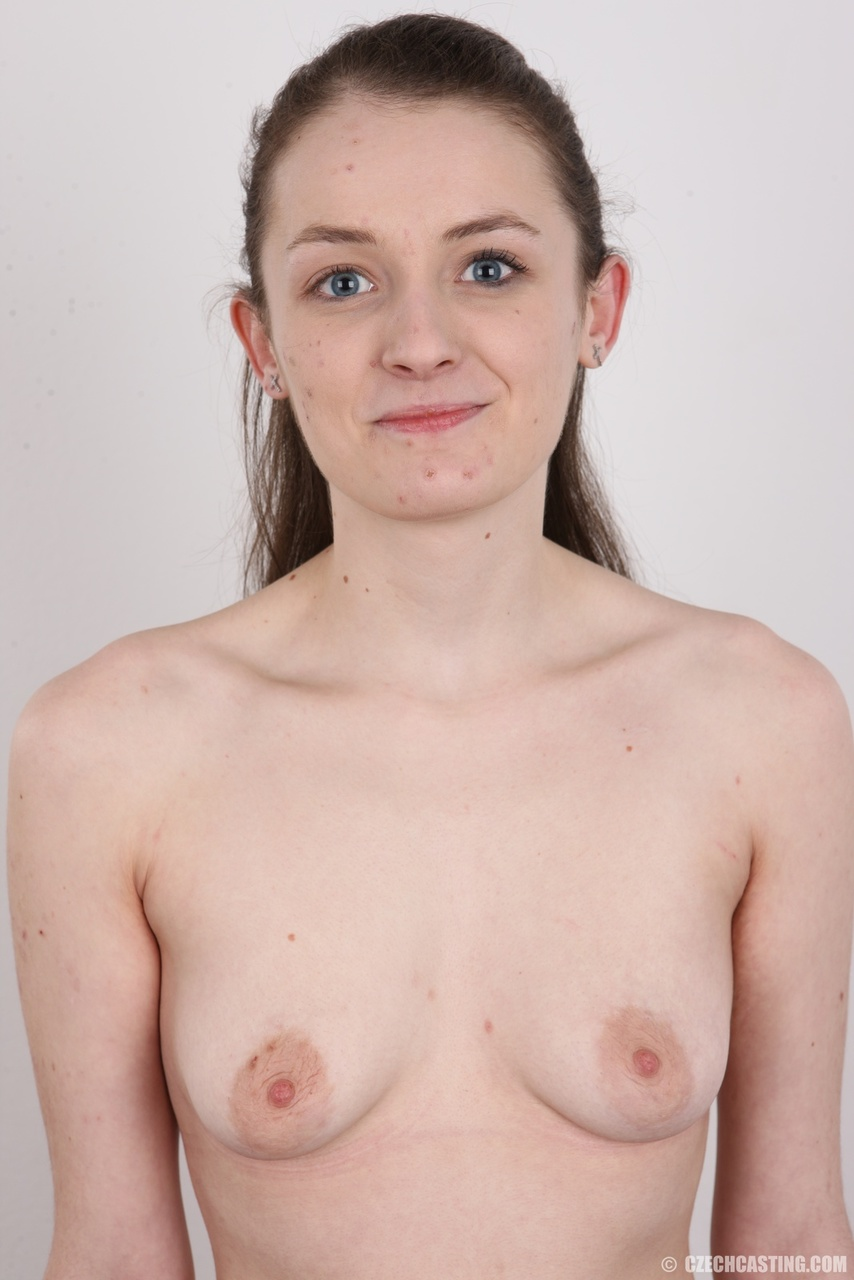 Young amateur Eliska sheds clothing to display tiny tits with nipples closeup