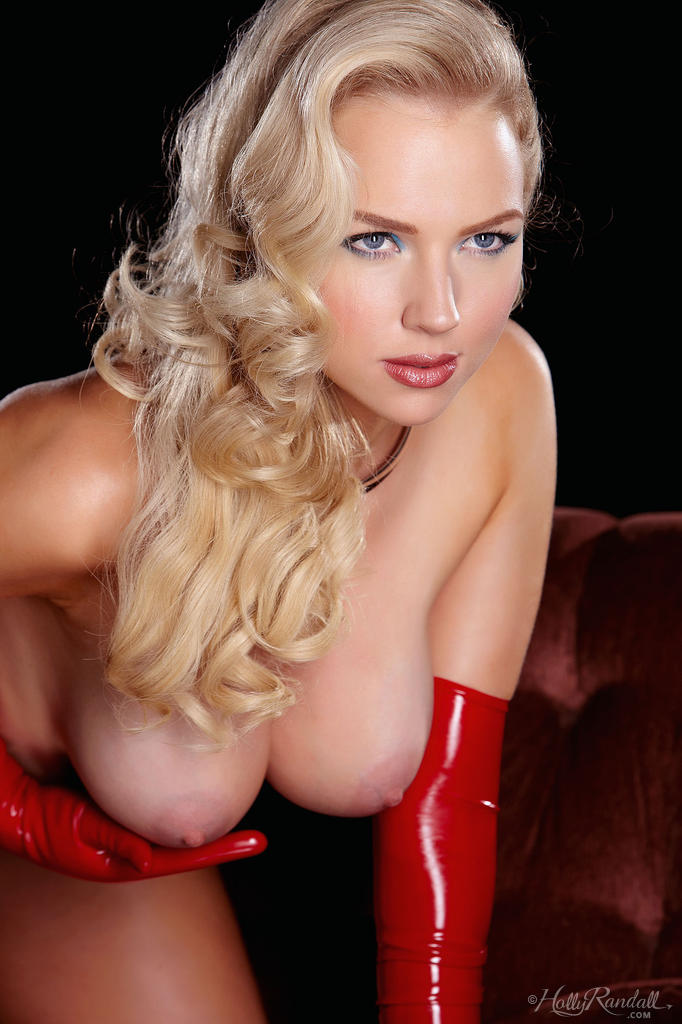 hot blonde glamour model ancilla tilia doffing her red latex to show