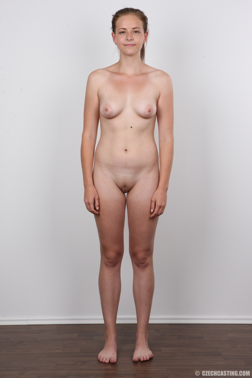 Young girl Magdalena removes her skirt and then her undergarments to pose nude
