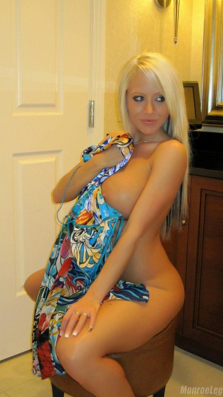Beautiful busty blonde Monroe Lee sheds her long dress to bare her ripe melons