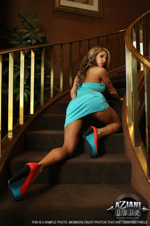Dirty blond female Abby Marie unveils her huge clit as she undresses