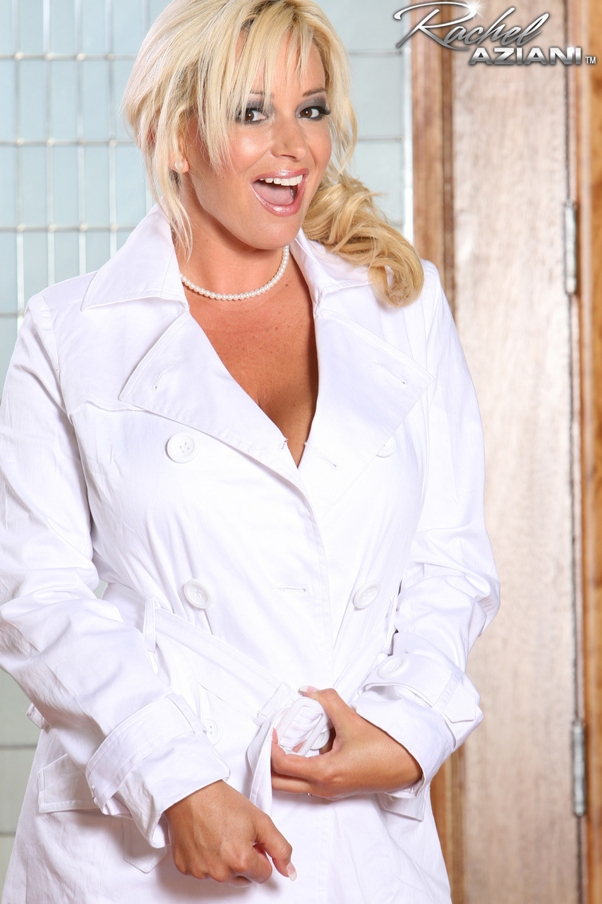 Busty blonde Rachel Aziani whipping out those luscious huge breasts in boots