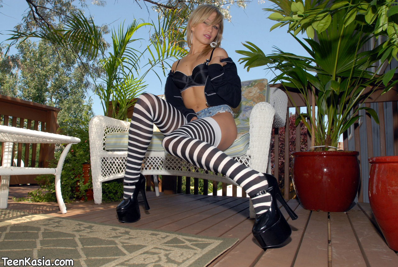 Amateur solo girl Teen Kasia goes topless on patio in thigh high socks