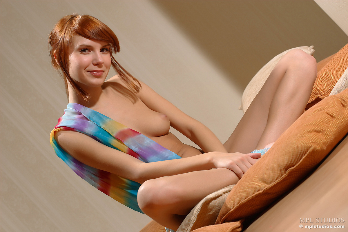 Glamour redhead model dances and poses completely naked in bed