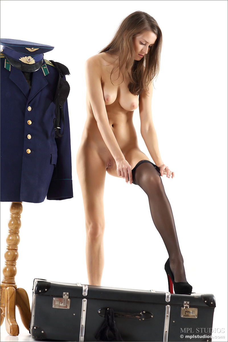 Slender busty girl undressing from her uniform to pose naked