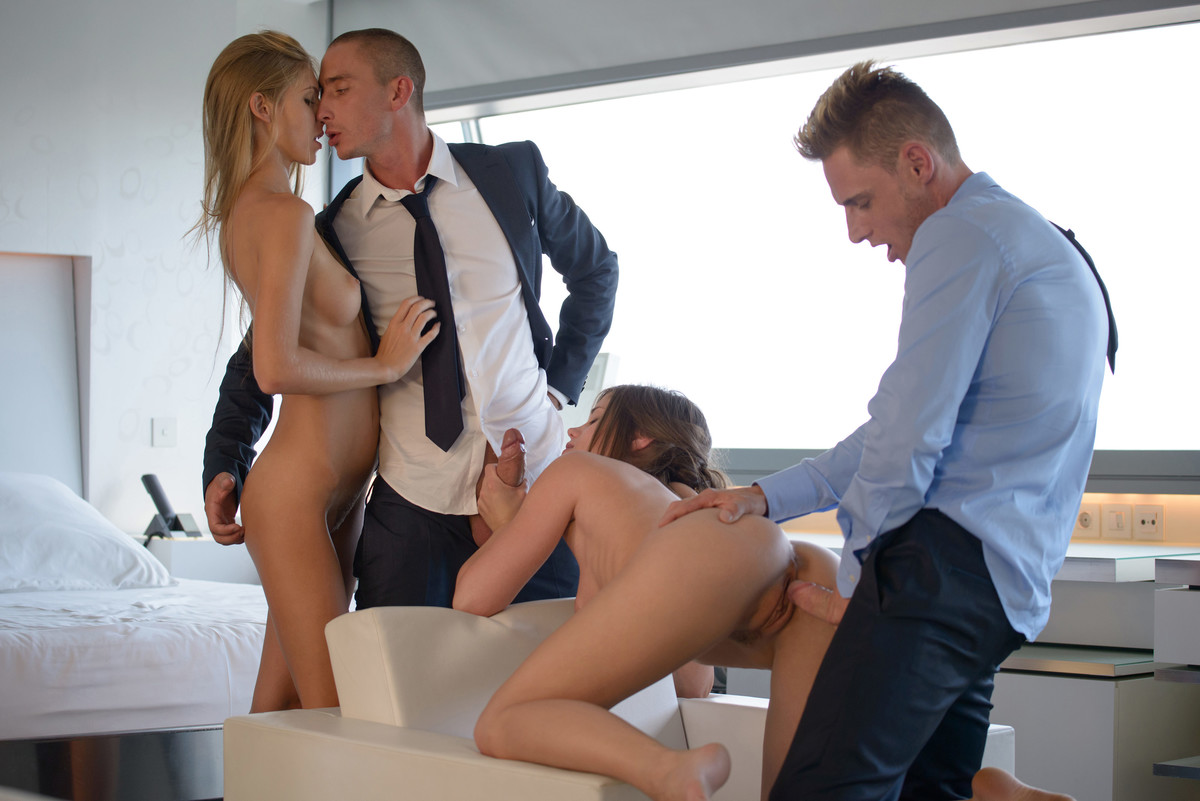 Hot bi escorts have a foursome with a couple of businessmen in executive suite