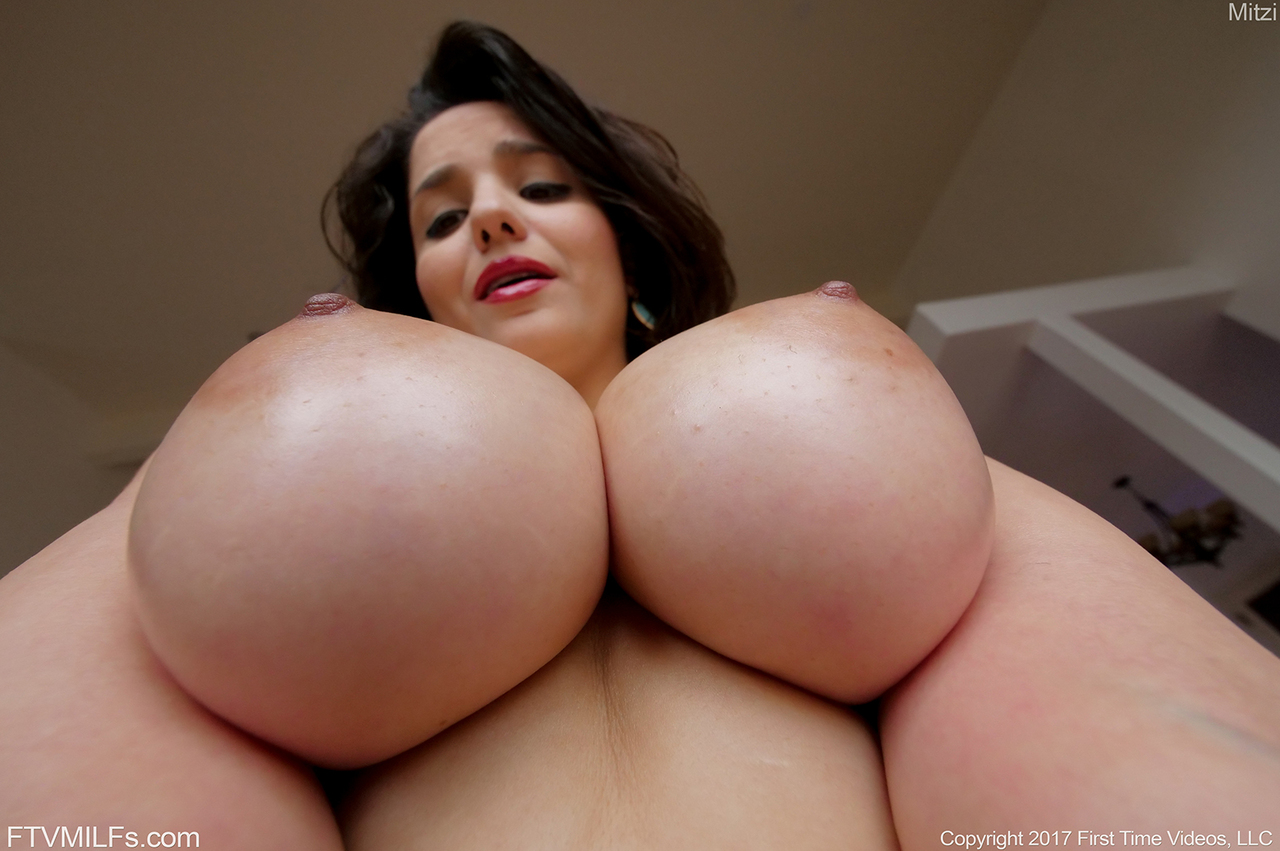 Big titted Mitzi frees her oiled huge boobs to show big nipples close up