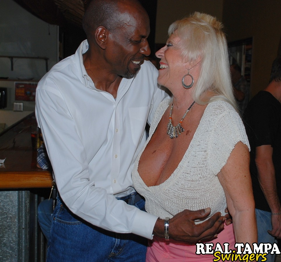 ... Horny granny enjoying some interracial sex fun at a steamy swingers  orgy ...