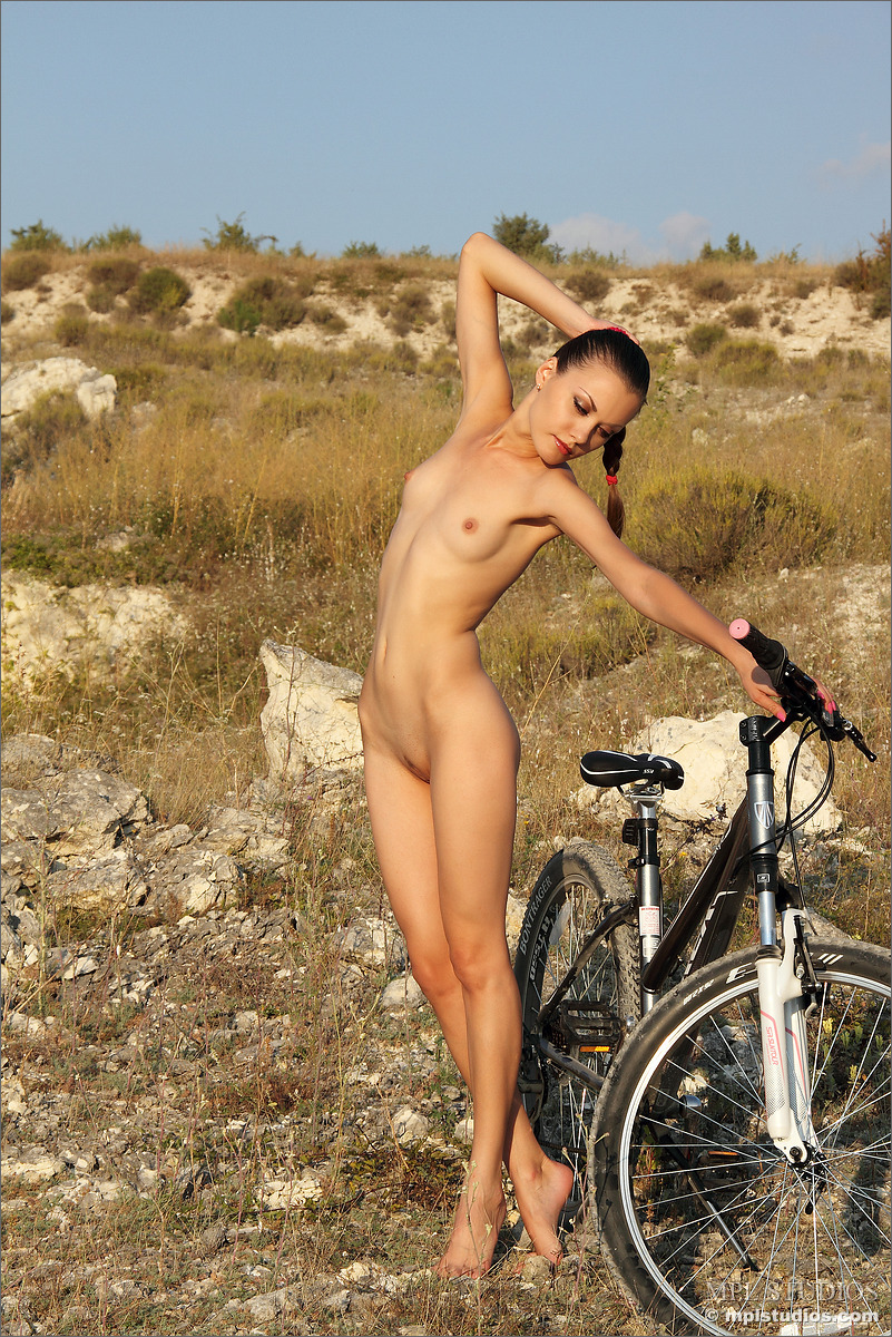 Naked skinny girl takes clothes off